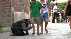 Person asking for money in Venice Italy - stock footage