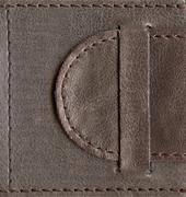 brown textured leather lock - stock photo