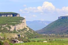 crimea mountain landscape with valley and village - stock photo