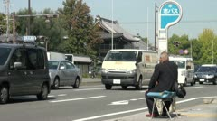 Senior man waits for the bus in Kyoto, public transport in Japan Stock Footage