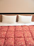 Bed with two pillows Stock Photos