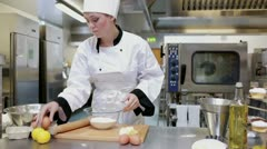 Cook standing in the kitchen and preparing dough Stock Footage