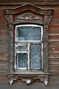 window of very old wooden house - stock photo