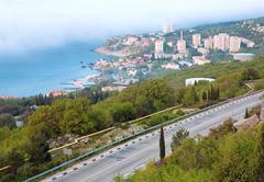 road on spring sea coastline - stock photo