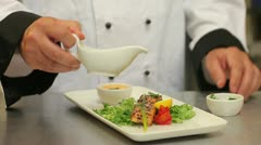 Cook presenting and finishing a meal Stock Footage
