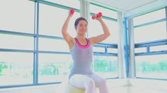 Woman doing exercise ball and dumbells Stock Footage