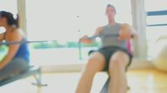 Stock Video Footage of Brunette man working out on row machine
