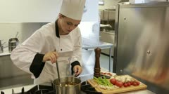 Cook preparing soup in the kitchen Stock Footage