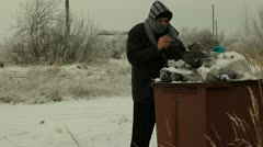 Homeless find  trousers Stock Footage