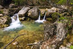 cascades on mountain river - stock photo