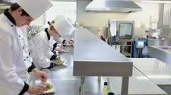 Chefs preparing a meal at a counter Stock Footage