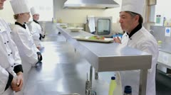 Head chef correcting the meals in the kitchen Stock Footage