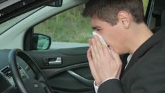 Sick man coughing and sneezes in the car HD Stock Footage