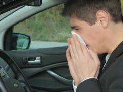 Sick man coughing and sneezes in the car NTSC Stock Footage