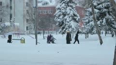People Walking on City Street in Winter Day Stock Footage