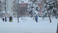 People Walking on City Street in Winter Day Stock Footage