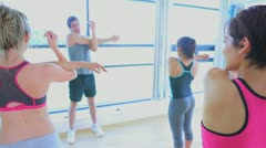 Video of trainer and class stretching arms Stock Footage