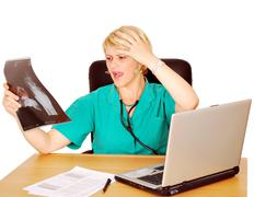 Female doctor looking at catastrophic results .JPG Stock Photos