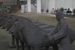 Horses and a soldier of terracotta army. - stock photo