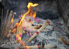 Incense burning in a temple. - stock photo