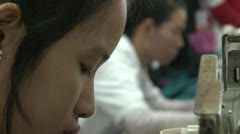 Textile Garment Factory Workers: CU Profile of Worker Face While Sewing Stock Footage
