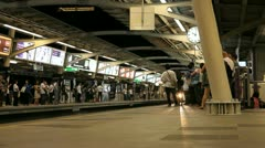 BTS train arriving at platform station, Bangkok, Thailand Stock Footage