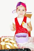little girl make and eat croissant.JPG - stock photo