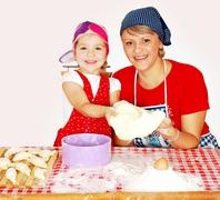 mother and daughter make croissants.JPG - stock photo