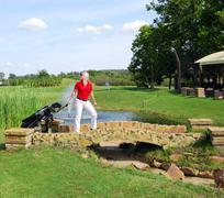 gilr goes to play golf.JPG - stock photo
