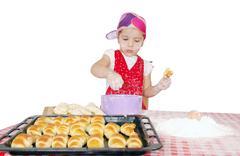 little girl make rolls with flour.JPG - stock photo