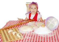 little girl with flour and rolls.JPG - stock photo