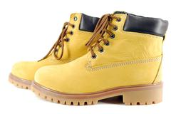 Yellow hiking boots.JPG Stock Photos