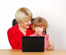 Stock Photo of woman and little girl with laptop.JPG