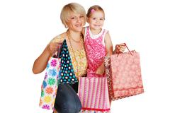 happy mother and daughter with shopping bags.JPG - stock photo
