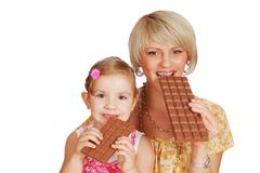 Mother and daughter with chocolate.JPG Stock Photos