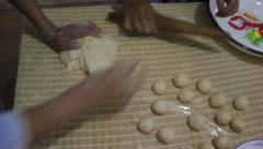 Rolling dough for traditional empanadas in Ecuador Stock Footage