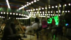 Carousel at night, defocused, interesting lights, cool weather - stock footage