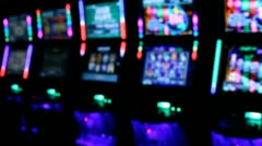 Slot machines videopoker glowing angle view Stock Footage