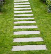 stone pavers in lawn - stock photo