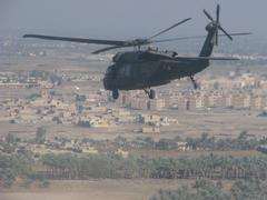Black hawk flying over Afghanistan (HD)c Stock Photos