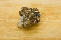 Maitake mushrooms on wooden table Stock Photos