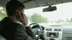 Young handsome man using mobile phone in the car HD - stock footage
