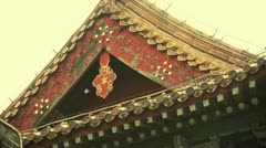 Carved beams & painted buildings.sculpture on roof eaves,China ancient. - stock footage