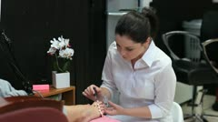 Beautician varnishing toenails Stock Footage