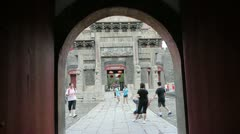 Through gate to see sculpture of ancient arch.China visitors & tourists. Stock Footage