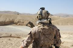 Soldier in full gear in Afganistan (HD)c Stock Photos