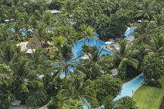 Tropical hotel resort swimming pools Mexico - stock photo