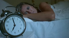Waking up woman pushing down the alarm cock - stock footage