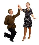 Pair perform a dance in the costumes of the 60s Stock Photos