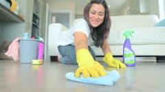 Video of brunette woman scrubbing the living room floor Stock Footage